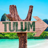 Tulum wooden sign with beach background