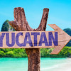 Yucatan wooden sign with beach background
