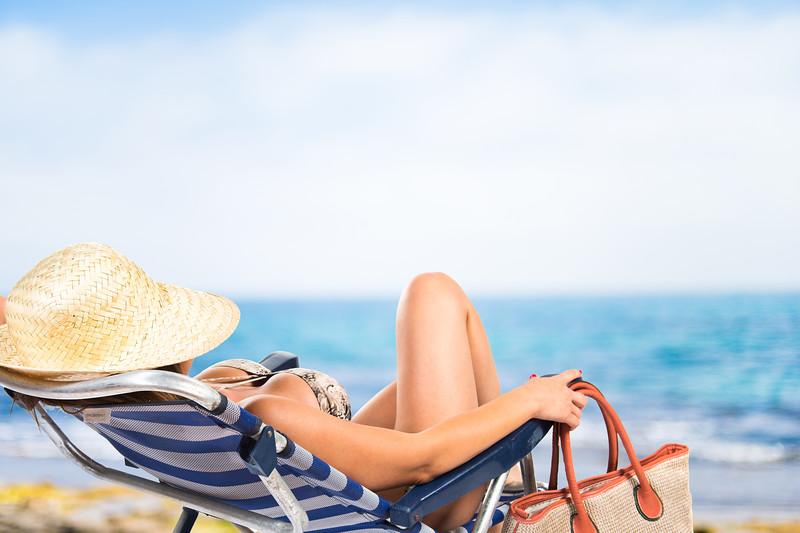 Woman resting on beach chair