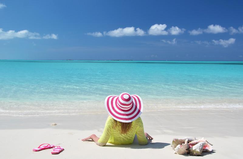 Girl relaxing on the beach of Exuma, Bahamas