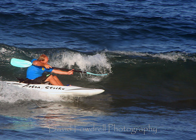 "Mike Lee doing the ever-coveted, extremely difficult, ""Shotgun"" maneuver in the surf kayak.  10's across the judges score cards."