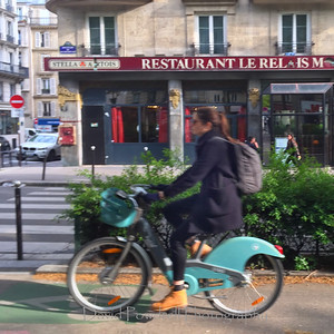 Paris includes Madame en  velo - Rue Rochechouart.