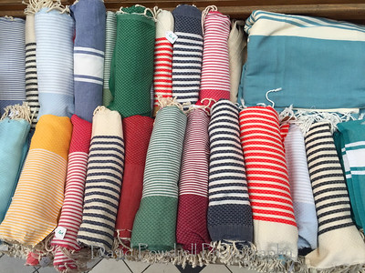 Paris is blues and greens and reds in varying widths of stripes.  Garment District - Martmontre