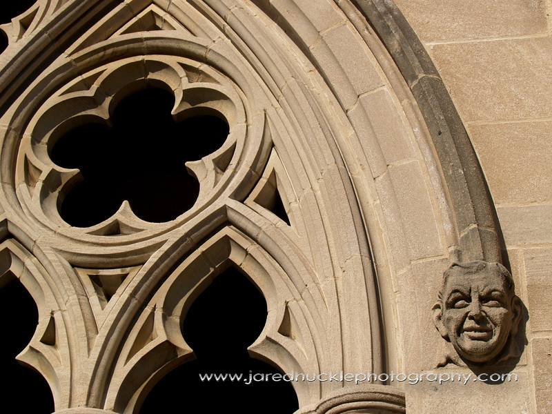 Window and face carving on Trinity College Chapel