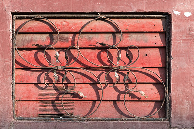 Decorative Metal Design over a Red Painted Vent