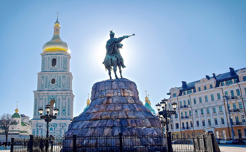 On the news this morning I heard about the ongoing troubles in the Ukraine and I was reminded of the opportunity to visit the capitol city in Kiev a year ago. It is a beautiful city and country whose people have endured many tragic burdens over the centuries.  <br /> <br /> Pictured here is Cossack leader Bohdan Khmelnytsky facing the iconically beautiful St. Sophia cathedral.<br /> <br /> I am afraid I can't do justice to that magnificent golden dome.