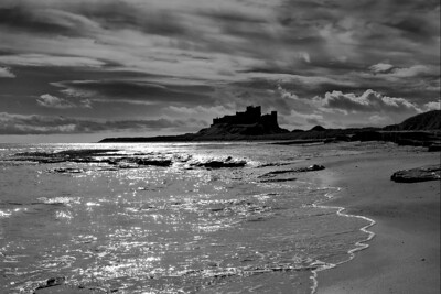 Beautiful Bamburgh Castle and beach on the Northumberland coast looking dramatic with this backlighting-induced silhouette treatment.