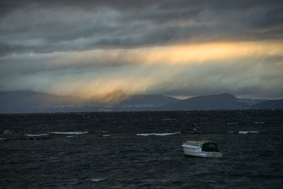 A windy night causing small craft to pitch about a bit at sunset over Lake Taupo.