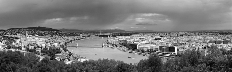 A midday storm passes quickly by the lovely city of Budapest.  Panorama of 8 stitched images taken from Gellert hill on the Buda side of the river.