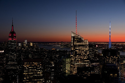 Manhattan at sunset with the iconic Empire State Building at the left of the frame.
