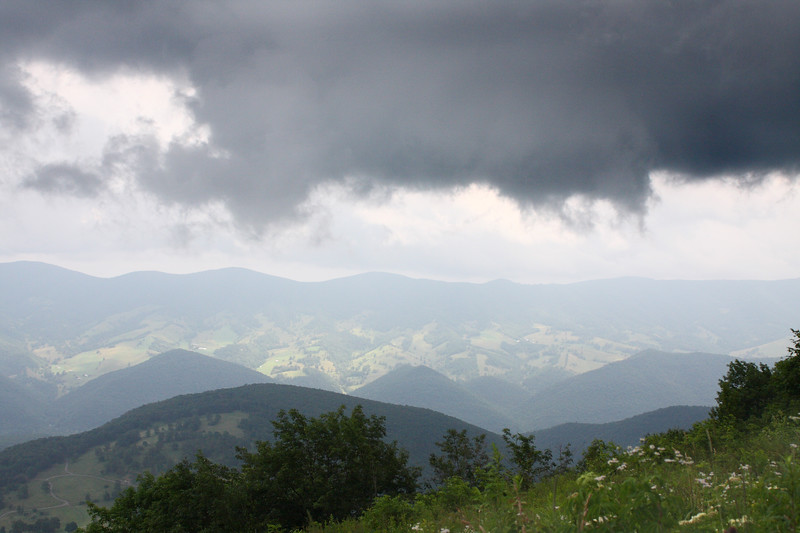 A storm cloud passes by so low you can almost reach out & touch it along the road to Spruce Knob, the highest point in West Virginia.