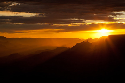A firey sunset cuts through the Grand Canyon.
