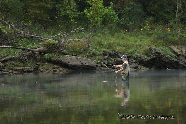 Some dude with a fly rod....I was fishing with a fly rod also.  The fish didn't seem to like what I was offering.