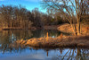A Warm Winter Afternoon Beside Still Waters - This High Dynamic Range Image resulted from combining five exposures ranging from -2 to +2.  The pond is located in the Saddle Creek Subdivision near Aledo, Texas.