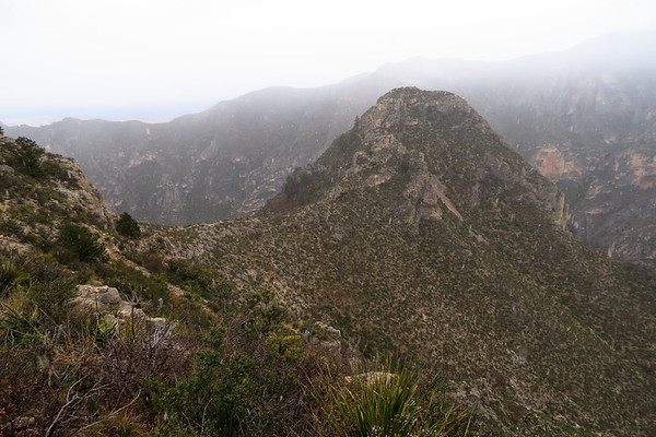 The trail runs right along that saddle up ahead and then up and around that mountain.  Yikes!