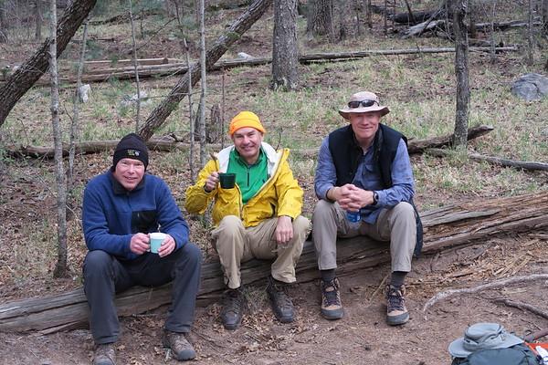 Tres Amigos enjoy a beverage and a log.