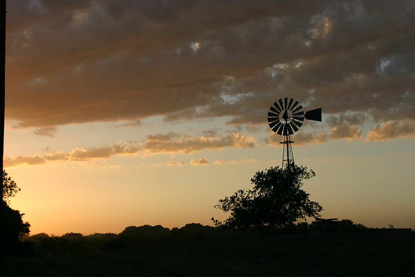 This windmill is located on Bear Creek Road near Kelly Road.  I shot it on Tuesday evening April 18, 2006.