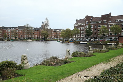 Amsterdam, The Netherlands - Canal intersection and typical residential buildings