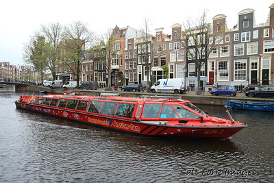 Amsterdam, The Netherlands - Sightseeing canal cruises are popular with the tourists