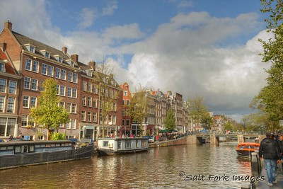 Amsterdam, The Netherlands - Blue skies over the canals as the overcast breaks.