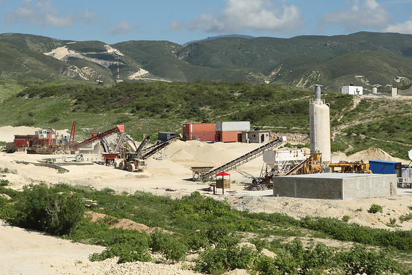 Topline Materiaux de Construction - Haiti.  Crushing and washing on the left.  Block-making on the right.  Maintenance and kitchen in the middle.