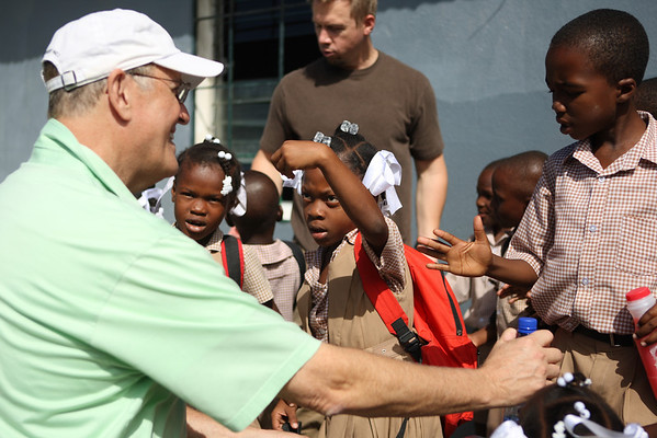 Flip was mobbed by children with lots to say - in Creole.