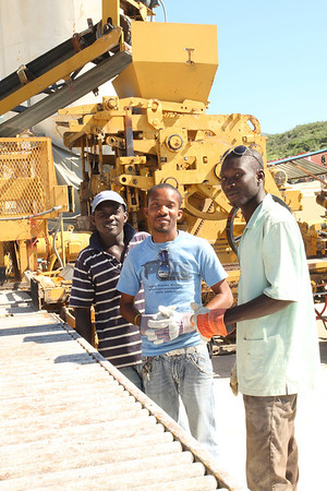 Hardworking Haitian employees of Topline Materiaux de Construction, Haiti