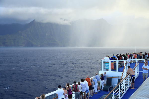 Everyone gathered on the port side of the ship to view the Na Pali coast of Kuaui.  But, uh-oh, check out that rain falling up ahead.