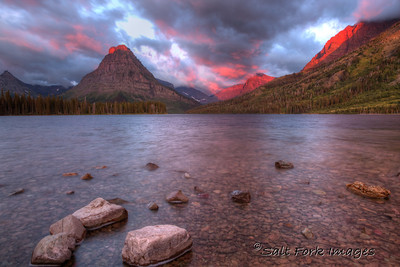 "Sinopah Mountain (Blackfoot for ""kit fox"") starts to light up with the sunrise over Two Medicine Lake in Glacier National Park, Montana"