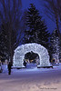 This arch is one of four located on the corners of the town square in Jackson, Wyoming.  The arch is made entirely of elk antlers and is wrapped in white Christmas lights.  This shot was taken on Christmas Eve, 2008.  The temperature was about 5 degrees at the time.