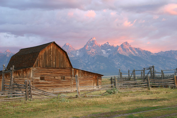 This is one of the barns on Mormon Row in Grand Teton National Park near Jackson, Wyoming.  I took this photo at about 6:30 am on August 1, 2005.  The color in this photo has not been manipulated.  The beautiful purples and pinks lasted for about five minutes as the sun rose.  Once the sun got above the low clouds behind me, the color of the mountains in front of me changed to a dull gray.  Check out the other barn photos and notice the dull gray mountains in the background.  Same morning - 30 minutes later.