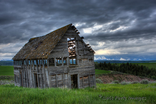 This old barn is one of my favorites.  It stands high on a hill overlooking the highway near the Fremont / Teton County line in southeastern Idaho.