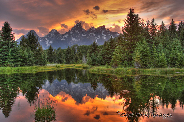 Sunset at Schwabacher's Landing in Grand Teton National Park.  The camera has a hard time capturing the range of exposure in this scene so I helped it out with a little High Dynamic Range processing.  I hope you like it.