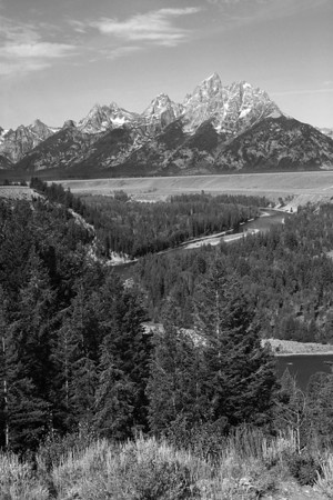 This is the spot where Ansel Adams took his famous photo in 1942.  Back then the trees in the foreground did not block the view of the curve in the Snake River.  Even though the view is different today, it remains one of the most popular photo spots in Grand Teton National Park.