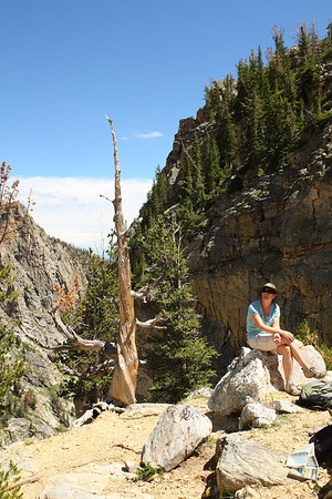 Jill sits with her back to Glacier Gulch.  This is the view from the saddle just to the north of and above Amphitheater Lake - GTNP