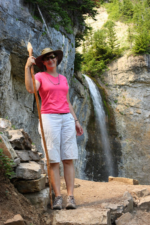 Jill strikes a pose in front of the waterfall below the mouth of Wind Cave.