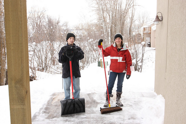 Aaron and Sara earned their hot chocolate by cleaning off the deck.  There was about 14 inches of snow piled up from the most recent storm.