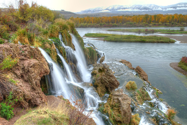 Fall Creek Falls bounds over the edge of the mountain into the Snake River in Swan Valley, Idaho