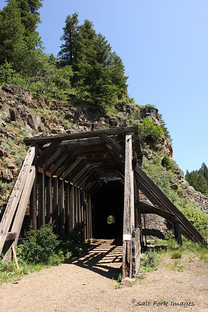 This tunnel was built by the Oregon Short Line Railroad between Ashton, Idaho, and West Yellowstone, Montana.  The tunnel was built through the mountain to avoid the frequent rockslides that were closing the tracks.
