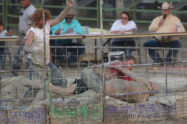 The adult divisions used 200 pound porkers and a full-sized barrel...... and more mud!