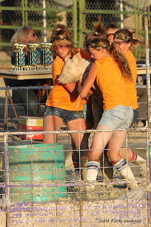 These girls won the 9-14 division by putting the pig in the barrel in about 10 seconds.