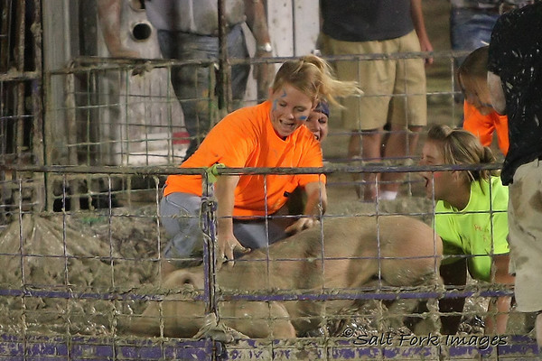 Check out the girl behind the pig....