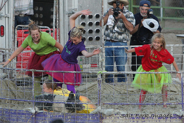 These girls never caught the pig but it's pretty clear they had fun trying.