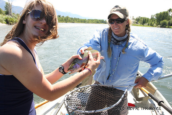 Sara and Greta - our guide - pose with Sara's rainbow trout.