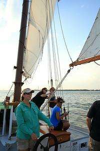 Captain Sarah guides Schooner PRIDE around Charleston Harbor.