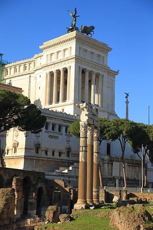Ruins of the Roman Forum with the Alter to the Fatherland (Altare della Patria) in the background - Rome, Italy
