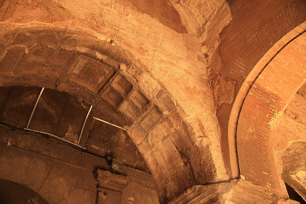 Evidence of the ornate plasterwork on the barrel-vaulted ceilings inside the passageways of the Colosseum in Rome