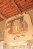 13th century painting on the wall in a public space in San Gimignano, Italy