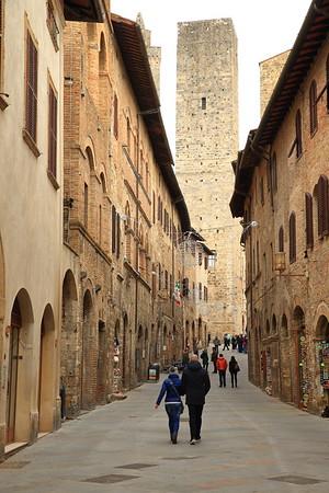 City street inside the walls at San Gimignano, Italy