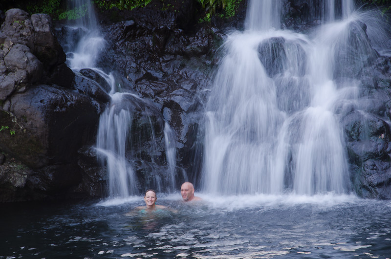 A couple enjoys the soothing waterfalls